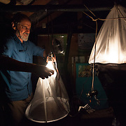 Dr. Alexander Sasha Konstantinov uses light traps, known as Berlese Funnels, to collect tiny beetles found in moss. The moss is heated by the light in the funnel and the beetles flee the heat, falling into collecting bags below.