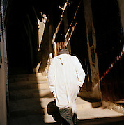 A man walks through the shadowy, narrow streets of Fes in Morocco