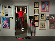 Bobby Hinds, 82, founder of LifelineUSA, does chin ups at his office. (Photo © Andy Manis)
