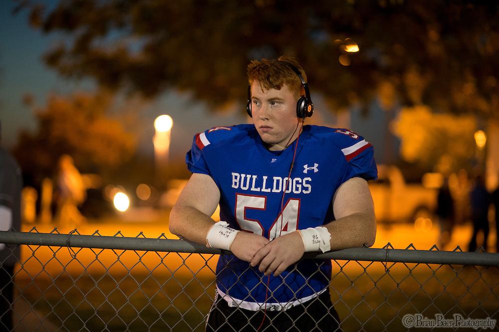 Folsom High School Bulldogs Noah Lunday (54), watches the JV game before the game as the Folsom High School Bulldogs varsity football team host the Oak Ridge High School Trojans,  Friday Nov 4, 2016.<br /> photo by Brian Baer