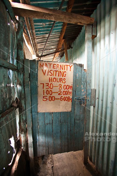 Nairobi, June 2010 -  simple door leads from the waiting room at the agape hope center to the maternity ward.