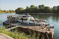 A Dniester River cruise boat soon to depart with its passengers on a one-hour cruise in Tiraspol, Transnistria.<br /> <br /> (September 10, 2016)