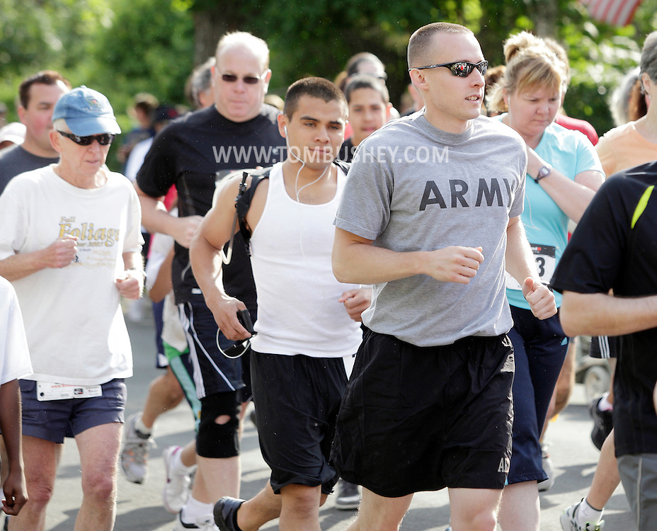 Middletown, New York - Runners take off at the start of the 15th annual Ruthie Dino Marshall 5K Run and Fun Walk hosted by the Middletown YMCA on Sunday, June 5, 2011.
