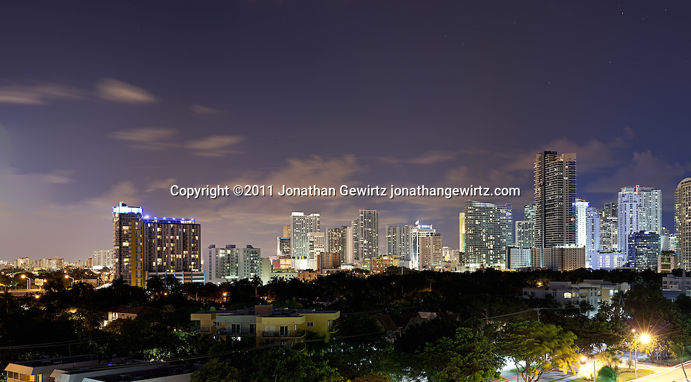 Panoramic view of Brickell Avenue and downtown Miami high-rise condominium, rental and office buildings at night. WATERMARKS WILL NOT APPEAR ON PRINTS OR LICENSED IMAGES.