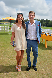 LYDIA BARLOW and HUGO CORDLE at the Veuve Clicquot Gold Cup Final at Cowdray Park Polo Club, Midhurst, West Sussex on 20th July 2014.