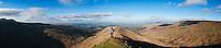 Female hiker on mountain ridge near summit of Fan Y Big, Brecon Beacons national park, Wales