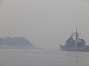 US military boat in fog harbor Yokosuka Japan
