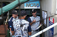 31 May 2016: Nova Southeastern head coach Greg Brown (right) talks with Brandon Gomez (24) before the game. The Nova Southeastern University Sharks played the Lander University Bearcats in Game 8 of the 2016 NCAA Division II College World Series  at Coleman Field at the USA Baseball National Training Complex in Cary, North Carolina. Nova Southeastern won the game 12-1.
