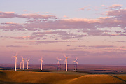 Wind turbines at sunset at a wind farm in Southern Wyoming.