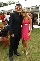 SHANE RITCHIE and girlfriend CHRISTIE GODDARD at the Kuoni World Class Polo Day held at Hurtwood Park Polo Club, Surrey on 29th May 2005.<br /><br />NON EXCLUSIVE - WORLD RIGHTS