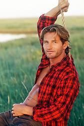 man on a rope swing in rural America