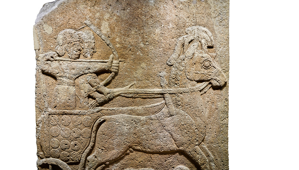Hittite relief sculpted orthostat stone panel of Long Wall Limestone, Karkamıs, (Kargamıs), Carchemish (Karkemish), 900 - 700 B.C. Anatolian Civilisations Museum, Ankara, Turkey<br /> <br /> Chariot. One of the two figures in the chariot holds the horse's headstall while the other throws arrows. There is a naked enemy with an arrow in his hip lying face down under the horse's feet It is thought that this figure is depicted smaller than the other figures since it is an enemy soldier. The lower part of the orthostat is decorated with braiding motifs. . <br /> <br /> On a White Background. .<br />  <br /> If you prefer to buy from our ALAMY STOCK LIBRARY page at https://www.alamy.com/portfolio/paul-williams-funkystock/hittite-art-antiquities.html  - Type  Karkamıs in LOWER SEARCH WITHIN GALLERY box. Refine search by adding background colour, place, museum etc.<br /> <br /> Visit our HITTITE PHOTO COLLECTIONS for more photos to download or buy as wall art prints https://funkystock.photoshelter.com/gallery-collection/The-Hittites-Art-Artefacts-Antiquities-Historic-Sites-Pictures-Images-of/C0000NUBSMhSc3Oo