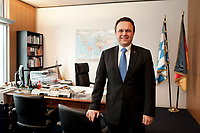 03 JAN 2011, BERLIN/GERMANY:<br /> Hans-Peter Friedrich, MdB, CSU, Vorsitzender der CSU Landesgruppe im Deutschen Bundestag, vor seinem Schreibtisch, in seinem Buero, Jakob-Kaiser-Haus, Deutscher Bundestag<br /> IMAGE: 20110103-01-044