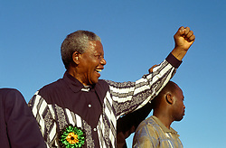 NELSON ROLIHLAHLA MANDELA (July 18, 1918 - December 5, 2013), 95, world renown civil rights activist and world leader. Mandela emerged from prison to become the first black President of South Africa in 1994. As a symbol of peacemaking, he won the 1993 Nobel Peace Prize. Joined his countries anti-apartheid movement in his 20s and then the ANC (African National Congress) in 1942. For next 20 years, he directed a campaign of peaceful, non-violent defiance against the South African government and its racist policies and for his efforts was incarcerated for 27 years. Remained strong and faithful to his cause, thru out his life, of a world of peace. Transforming the world, to make it a better place. PICTURED: Nelson Mandela election campaign, ahead of the first non racial elections in South Africa, 1994