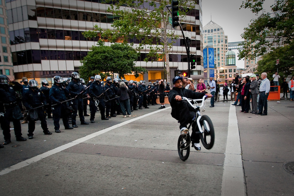 A peaceful demonstration to protest the unjust verdict of Involuntary Manslaughter given on the shooting of 22 year old African American young man, Oscar Grant, by BART officer Johannes Mehserle turns into a riot in downtown Oakland.  Oakland Police officers in riot gear disperses the crowd estimated around 800 people that congregated around Broadway and 14th. Street after declaring unlawful assembly on the crowd.  At the end of the night, at least 50 protesters were arrested and many stores in the vicinity were vandalized and looted.