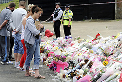 © Licensed to London News Pictures. 15/08/2012. Natalie Sharp, mother of Tia Sharp, holding a picture of Tia Sharp at a memorial for the 12 year old on The Lindens, New Addington on August 15, 2012. Tia's mother Natalie Sharp and Tia's Step Father David Niles visit the memorial for half an hour as Tia's Step Grandfather, Stuart Hazell appeared at the Old Bailey by video link charged with murder. Photo credit : Grant Falvey/LNP