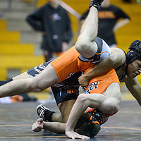 Gallup Bengal Blake Wallace rolls Aztec Tiger Brandon Trennepohl during a district meet at Gallup High School Saturday.