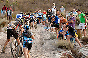 Local crowds cheer on the riders as they climb a steep sandy section during stage 6 of the 2011 Absa Cape Epic Mountain Bike stage race held in and around Oak Valley on the 2nd April 2011..Photo by Greg Beadle/Cape Epic/SPORTZPICS