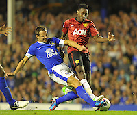 Manchester United's Danny Welbeck and Everton's Phil Jagielka battle for the ball..Football - Barclays Premiership - Everton v Manchester United - Monday August 20th 2012 - Goodison Park - Liverpool..