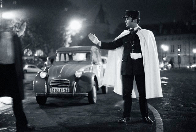 31 Dec 1974, Paris, France --- Gendarme in Cape Directing Traffic --- Image by  Owen Franken