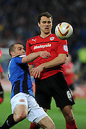 Cardiff city's Ben Turner battles for the ball with Barnsley's Stephen Dawson (l). Npower championship, Cardiff city v Barnsley at the Cardiff city stadium in Cardiff, South Wales on Tuesday 9th April 2013. pic by Andrew Orchard,  Andrew Orchard sports photography,