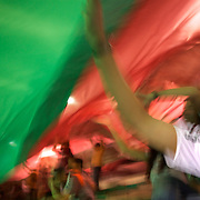 Fluminense fans pull the teams flag over themselves during the Fluminense V  Palmeiras, Futebol Brasileirao  League match at the Jornalista Mário Filho Maracana Stadium, The match ended in a 1-1 draw, Rio de Janeiro,  Brazil. 1st September 2010. Photo Tim Clayton.