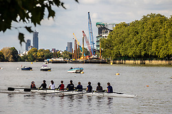 Licensed to London News Pictures. 21/09/2021. Surrey, UK. Rowers enjoy the sunshine on the Thames at Putney, south-west London today as weather forecasters predict warm autumnal weather for the next 7 days with highs of 24c.  Photo credit: Alex Lentati/LNP