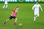 Steven Davis of Southampton (l) goes past Fernando Llorente of Swansea city.Premier league match, Swansea city v Southampton at the Liberty Stadium in Swansea, South Wales on Tuesday 31st January 2017.<br /> pic by  Andrew Orchard, Andrew Orchard sports photography.