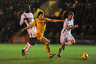 Newport county's Ryan Burge © is fouled by Wimbledon's Will Antwi (l). Skybet football league 2 match, Newport county v AFC Wimbledon at Rodney Parade in Newport, South Wales on Tuesday 25th Feb 2014.<br /> pic by Andrew Orchard, Andrew Orchard sports photography.