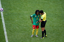 Match referee Qin Liang speaks with Cameroon's Gabrielle Aboudi Onguene after England's Ellen White (not in picture) scores her side's second goal of the game, originally given as offside but overturned by VAR, during the FIFA Women's World Cup, round of Sixteen match at State du Hainaut, Valenciennes.