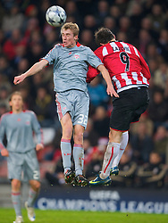 EINDHOVEN, THE NETHERLANDS - Tuesday, December 9, 2008: Liverpool's Stephen Darby and PSV Eindhoven's Danko Lazovic during the final UEFA Champions League Group D match at the Philips Stadium. (Photo by David Rawcliffe/Propaganda)