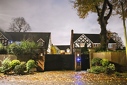 © Licensed to London News Pictures . Salford , UK . FILE PICTURE DATED just after midnight on 02/11/2020 of the driveway gate for number 19 Chatsworth Road . Police were parked on Chatsworth Road , Worsley , in close approximation to the driveway gate for number 19 , from where police officers were later seen exiting . Today , 23rd April 2021 , Ryan Giggs (dob 29/11/1973) has been charged with causing actual bodily harm to a woman in her 30s and common assault of a woman in her 20s in relation to incidents that took place on the evening of Sunday 1st November 2020 and has further been charged with one count of coercive and of controlling behaviour between December 2017 and November 2020 . Photo credit : Joel Goodman/LNP