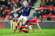 Tom Flanagan (#12) of Sunderland AFC tackles Danny Hylton (#9) of Luton Town FC in the box to concede a penalty during the EFL Sky Bet League 1 match between Sunderland AFC and Luton Town at the Stadium Of Light, Sunderland, England on 12 January 2019.