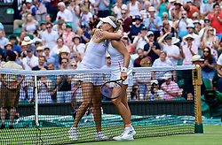 LONDON, ENGLAND - Tuesday, July 2, 2019: Angelique Kerber (GBR) (R) hugs Tatjana Maria (GER)  after the Ladies' Singles first round match on Day Two of The Championships Wimbledon 2019 at the All England Lawn Tennis and Croquet Club. (Pic by Kirsten Holst/Propaganda)