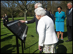 April 18, 2018 - London, London, United Kingdom - Commonwealth Walkway project. Queen Elizabeth II and Hugo Vickers during the unveiling of a panel marking the walkway in Buckingham Palace gardens, London, in relation to the Commonwealth Walkway projec  (Credit Image: © i-Images via ZUMA Press)