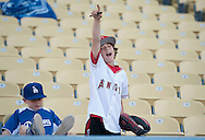 An Angels' fan cheers on his team before the Angels' Freeway Series game against the Dodgers Thursday night at Dodger Stadium.