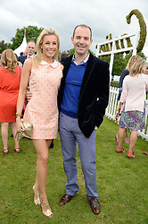 MARTIN LEWIS and his wife LARA LEWINGTON at the 2013 Cartier Queens Cup Polo at Guards Polo Club, Berkshire on 16th June 2013.