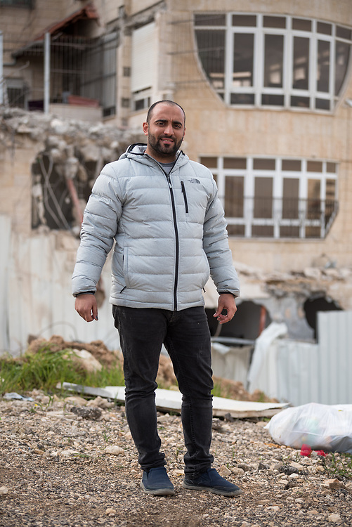29 February 2020, Jerusalem: 26-year-old Mohammad Bashiti stands in front of his home in the Shu'fat village in Jerusalem, where he has just had a part demolished. As building permits are notoriously difficult, in some cases impossible, for Palestinians to obtain, demolition of houses stated not to have the relevant permits is common in the area. This time, the family lost their living room, two bathrooms, and kitchen.
