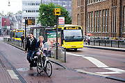 In Utrecht fietst een vrouw al bellend op de fiets door de binnenstad.<br /> <br /> In Utrecht a woman is cycling atthe city center while phoning.