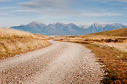 A dirt road winds through the National Bison Range Wildlife Refuge in northwestern Montana. Missoula Photographer, Missoula Photographers, Montana Pictures, Montana Photos, Photos of Montana