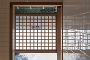 exit of a public toilet with no smoking sign on a screen Kioto Japan