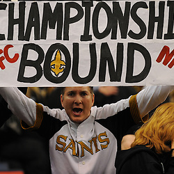 16 January 2010:  A New Orleans Saints fan holds up a sign following a 45-14 win by the New Orleans Saints over the Arizona Cardinals in the 2010 NFC Divisional Playoff game at the Louisiana Superdome in New Orleans, Louisiana.
