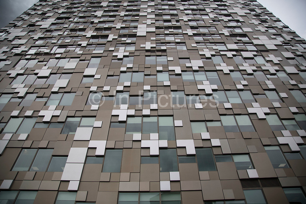 Exterior detail of The Cube building in Birmingham, United Kingdom. The Cube is a 25 storey mixed-use development in the centre of Birmingham, England. Designed by Ken Shuttleworth of MAKE Architects, it contains 135 flats, offices, shops, a hotel and a restaurant. It is the final phase of The Mailbox development.