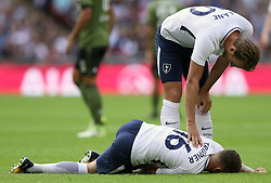 Tottenham Hotspur's Harry Kane checks on team mate Kieran Trippier after he goes down after a tackle during the pre-season friendly match at Wembley Stadium, London.