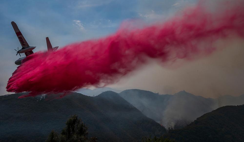 A Cal Fire plane drops fire retardant on the River Fire near Salinas, Calif. on Aug. 17, 2020.