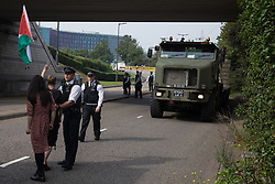 Human rights activists protest in front of a large military vehicle against the DSEI 2021 arms fair at ExCeL London on 6th September 2021 in London, United Kingdom. The first day of week-long Stop The Arms Fair protests outside the venue for one of the world's largest arms fairs was hosted by activists calling for a ban on UK arms exports to Israel.
