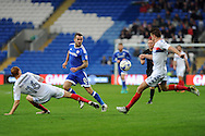 Cardiff City's Joe Ralls (8) passes past Wigan's Shaun MacDonald (16) and Reece Burke (r). EFL Skybet championship match, Cardiff city v Wigan Athletic at the Cardiff city stadium in Cardiff, South Wales on Saturday 29th October 2016.<br /> pic by Carl Robertson, Andrew Orchard sports photography.