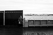Lady smoking a cigarette during her boat trip from Cacilhas to Belém ( Lisbon )<br /> Credit: Rodrigo Cabrita/4SEE