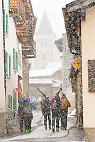 A group of skiers walk the streets of Bourge-St.-Pierre, Switzerland while touring the Haute Route.