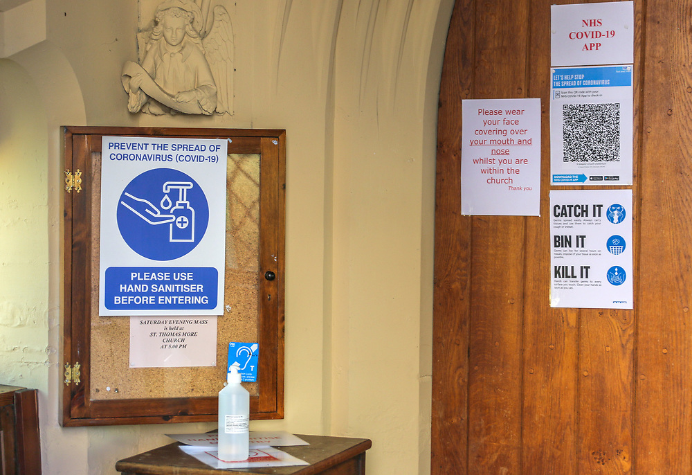 28th February, Cheltenham, England. AHand sanitiser and COVID based posters displayed at St Gregory's Catholic Church in Cheltenham during the third national lockdown owing to the Coronavirus Pandemic.